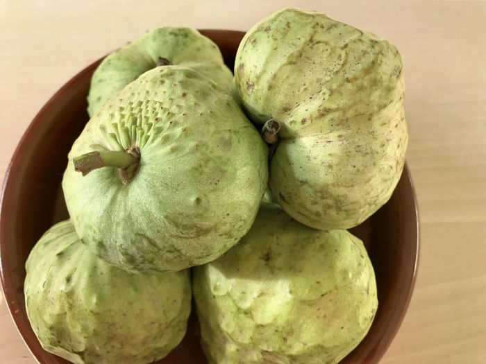 Bowl of chirimoya, custard apple, fruit Bowl Chirimoya Close-up Custard Apple Day Food Food And Drink Freshness Fruit Green Color Healthy Eating Indoors  No People Table