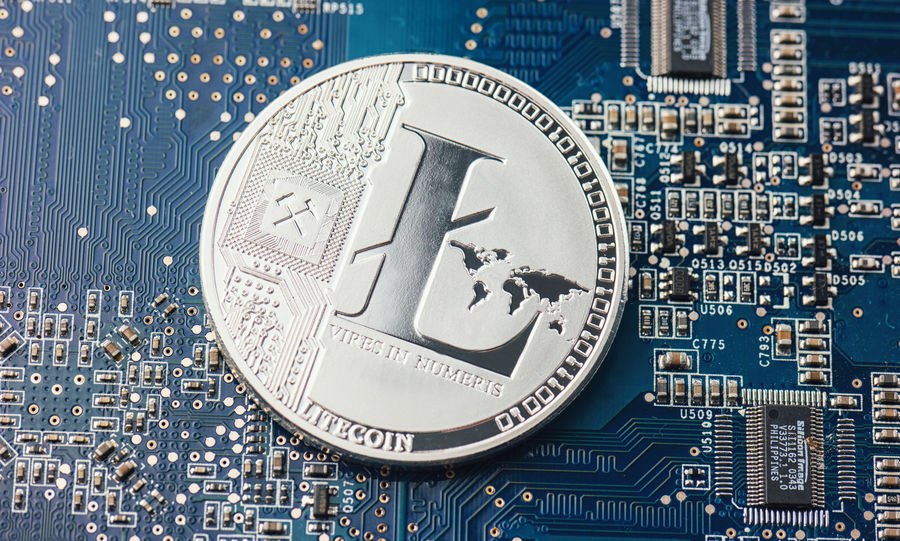 Silver Litecoin cryptocurrency on a motherboard, digital money Anonymous Business Currency Security Virtual Banking Bitcoin Blockchain Chip Coin Computer Cryptanalysis Cryptocurrency Cyberspace Ether Ethereum Financial Hacking Litecoin Mainboard Mining Motherboard Payment Silver  Technology