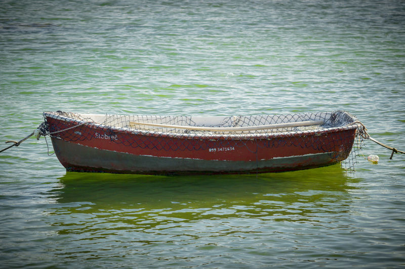 Small Boat Beauty In Nature Boat Day Lake Mode Of Transportation Moored Nature Nautical Vessel No People Outdoors Reflection Rippled Rowboat Summer Tranquility Transportation Travel Water Waterfront Wood - Material EyeEmNewHere The Traveler - 2018 EyeEm Awards