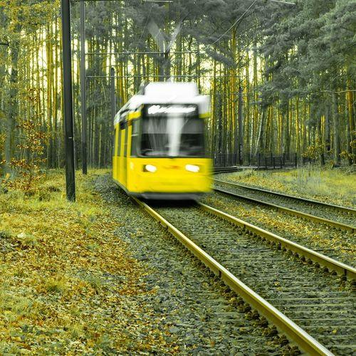 Yellow train on railroad track