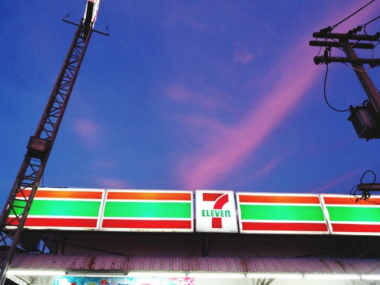 7-11 conveniencenstore minimart with evening sky Multi Colored Outdoors Day Low Angle View No People Sky 7-11 Minimart Convenient Store Light Shop Commercial Beauty In Nature Freshness