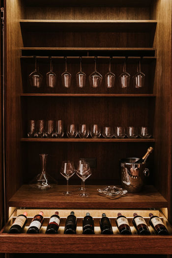 Shelf Indoors  Arrangement Large Group Of Objects No People Choice In A Row Wood - Material Variation Shelves Side By Side Order Still Life Food And Drink Container Household Equipment Rack Antique Abundance Glass Crockery Display Cabinet