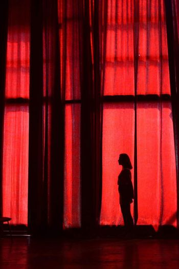 One Person Real People Silhouette Standing Childhood Full Length Side View Inner Power Stories From The City Indoors  Silhouette Red Lifestyles Architecture Curtain Built Structure Stage Standing Women Leisure Activity The Still Life Photographer - 2018 EyeEm Awards HUAWEI Photo Award: After Dark International Women's Day 2019