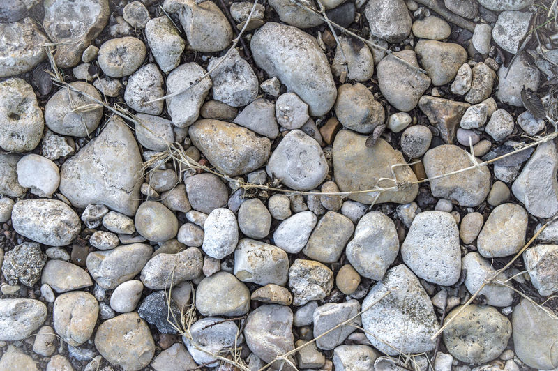 Solid Rock Stone - Object Full Frame Backgrounds Textured  Stone No People Nature Abundance Stone Wall Pattern Rough Outdoors Directly Above High Angle View Large Group Of Objects Day Pebble Rock - Object Gray Grey My Best Photo