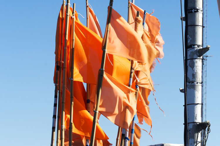 Fisherman's Flags Hanstholm Denmark Clear Sky Close-up Day Flag Low Angle View No People Orange Color Outdoors Sky Sunlight Yellow