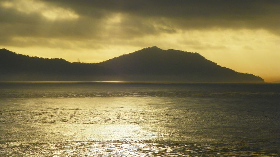 A view from the sea in the evening Beauty In Nature Cloud - Sky Day EyeEmNewHere Gold Color Golden Color Island Land Mountain Nature No People Outdoors Reflection Scenics Sea Sea And Sky Sea View Sky Sunset Tranquil Scene Tranquility Water
