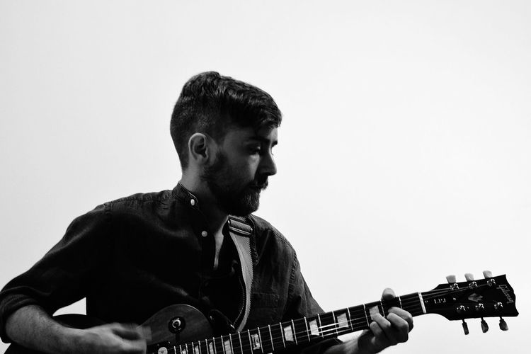White Background Musician Beard Rock Musician Portrait Headshot Plucking An Instrument Musical Instrument Close-up Guitarist Guitar Bass Guitar Musical Equipment Classical Guitar Acoustic Guitar Street Musician