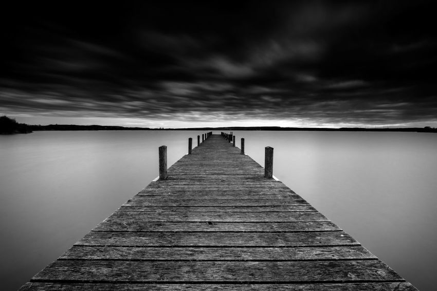 A Storm is coming Reflection Sea Water Pier Nature Outdoors Horizon Over Water Landscape Beauty In Nature No People Day Sunset Fujifilm Sky Taking Photos Cold Temperature Fuji Idyllic Scenics Lake Vacations Mystyle Edited Smooth Long Exposure