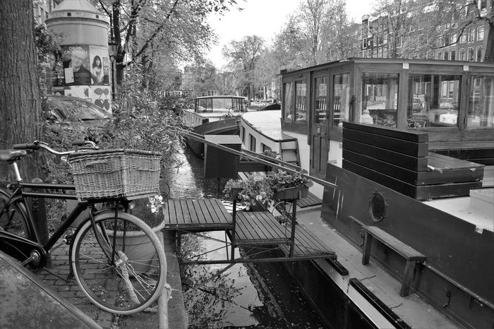 Architecture Bicycle Black & White Black And White Blackandwhite City City Canal Connection Day Houseboat Houseboats In Amsterdam Land Vehicle Mode Of Transport Monochrome Photography No People Outdoors Railing Steps Transportation Travel Destinations Traveling Tree
