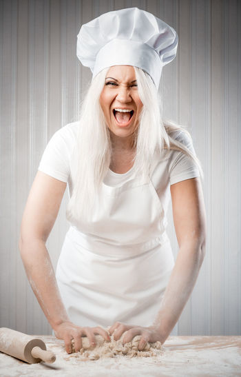Angry and stressed out woman cook Cook  Cooking Overworked Stress Woman Adult Blond Hair Bored Caucasian Chef Chef Hat Depression Dough Exhausted Fatigue  Female Indoors  Kitchen Nervous One Person Pastry Rolling Pin Stressed Tired Young Adult