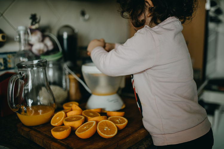 Midsection of girl preparing food