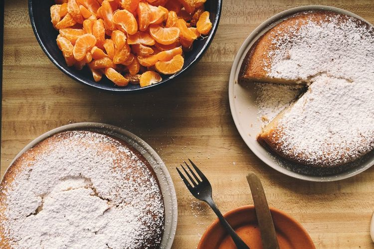 Birthday Cake Cake Cakes Cinnamon Day Egg Yolk Food Food And Drink Fork Freshness Fruit Fruitcake High Angle View Indoors  Mandarin Oranges No People Powdered Sugar Ready-to-eat Sweet Food Table