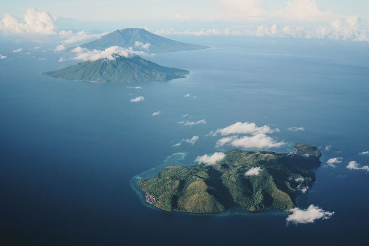 Aerial View ASIA Beauty In Nature Clouds Day Flying From An Airplane Window Green Island Horizon Over Water INDONESIA Islands Maluku  Moluccas Paradise Scenics Sea Spice Islands Sunny Day Ternate Tidore Tranquility Travel Travel Destinations Traveling Water The Great Outdoors - 2017 EyeEm Awards Lost In The Landscape Perspectives On Nature