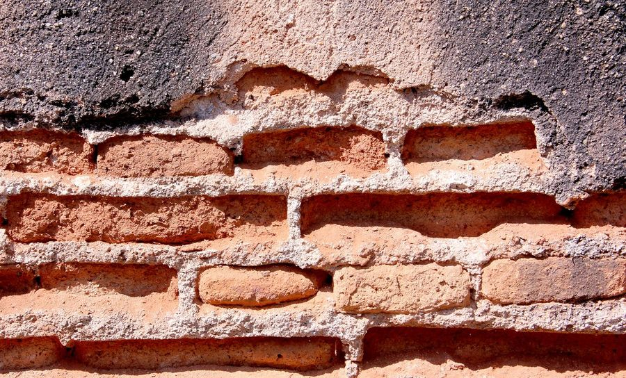 Red color brick wall with rupture in Thailand Wall Wall Background Red Brick Wall Brick Autumn Summer Home Old Wall Red Wall Structure Pattern Thailand Brick Background Healthcare Stone Building Stone Rural Cube Day Sand Full Frame Sunlight Shadow Outdoors No People Textured  Backgrounds Close-up