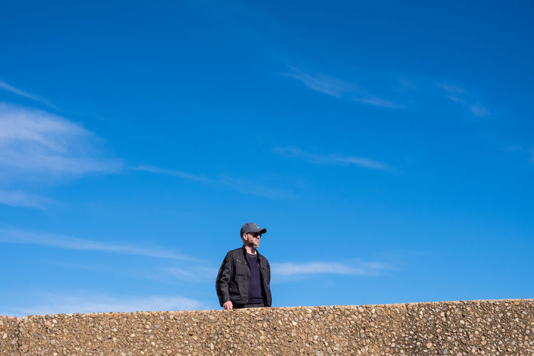 Man Standing Against Blue Sky