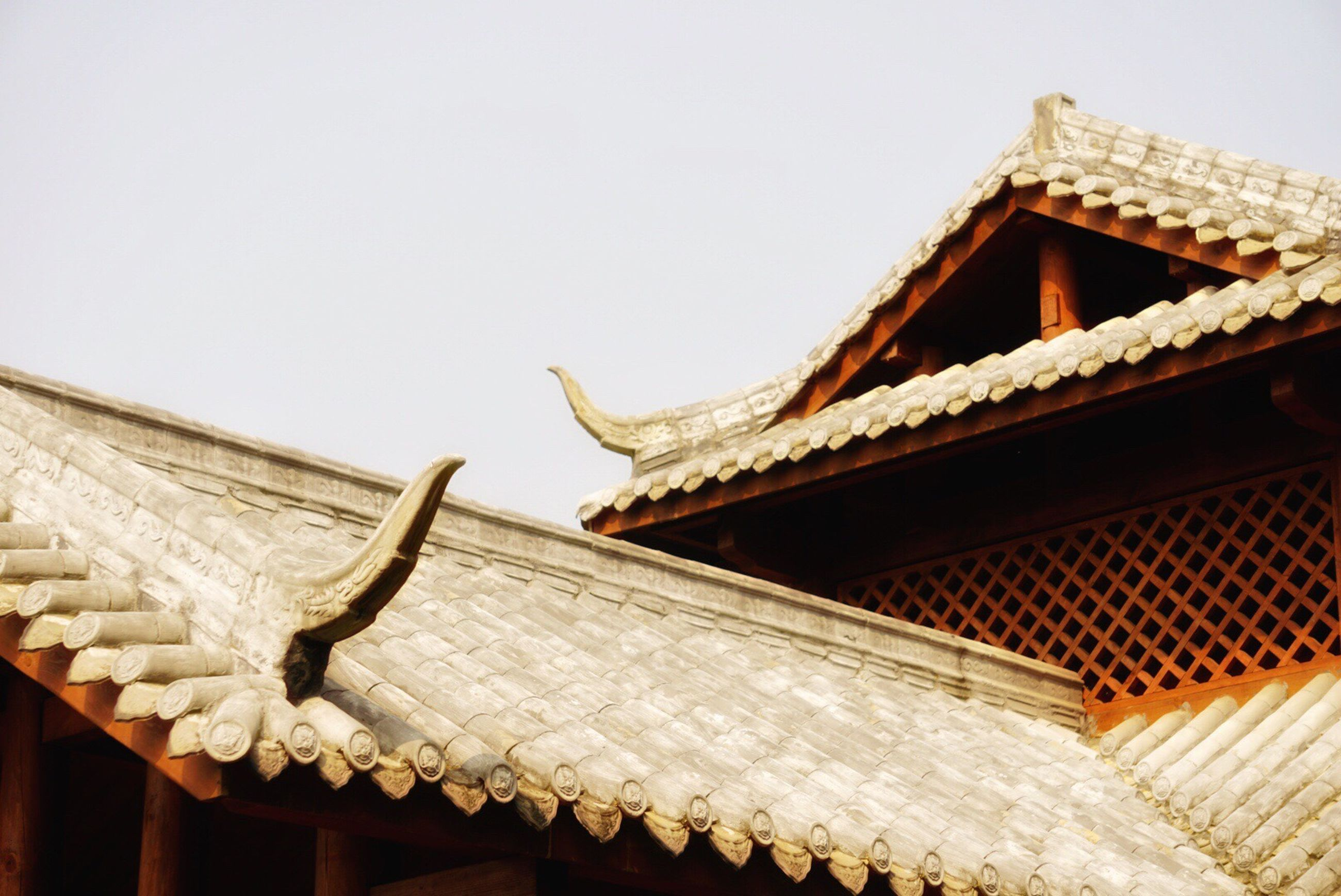 architecture, built structure, building exterior, low angle view, roof, no people, day, outdoors, traditional building, sky