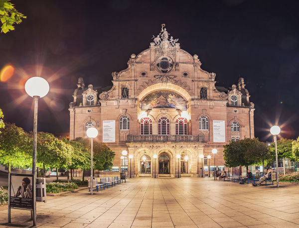 NUREMBERG, BAVARIA, GERMANY - CIRCA OCTOBER, 2018: The Staatstheater Nuernberg alias Opernhaus at night in Nuremberg, Germany Nuernberg, Nuremberg, The Opera House Of Nuremberg, Architecture, Baroque, Bavaria, Bavarian, Building, Editorial, Europe, Exterior, Famous, Formal, Germany, History, Lights, Music, Night, Old, Opera, Park, Residential, Sights, Sightseeing, Travel Architecture Belief Building Building Exterior Built Structure City History Illuminated Light Lighting Equipment Night Outdoors Place Of Worship Religion Sky Spirituality Street Street Light The Past Travel Travel Destinations