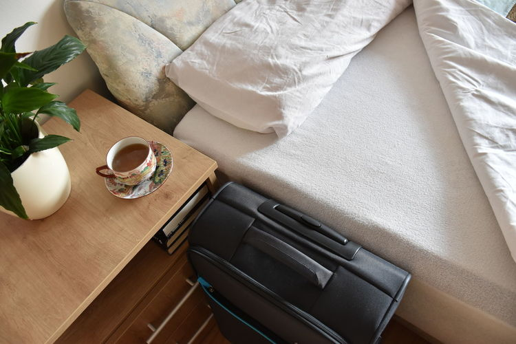 Bed Tea Bedroom Cup Drink Flower Food And Drink Freshness Furniture High Angle View Home Interior Indoors  Luggage No People Pillow Plant Refreshment Still Life Suitcase Tea Cup