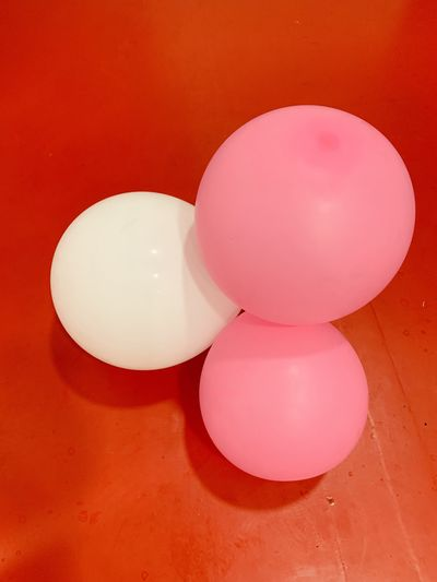 High angle view of multi colored balloons on table