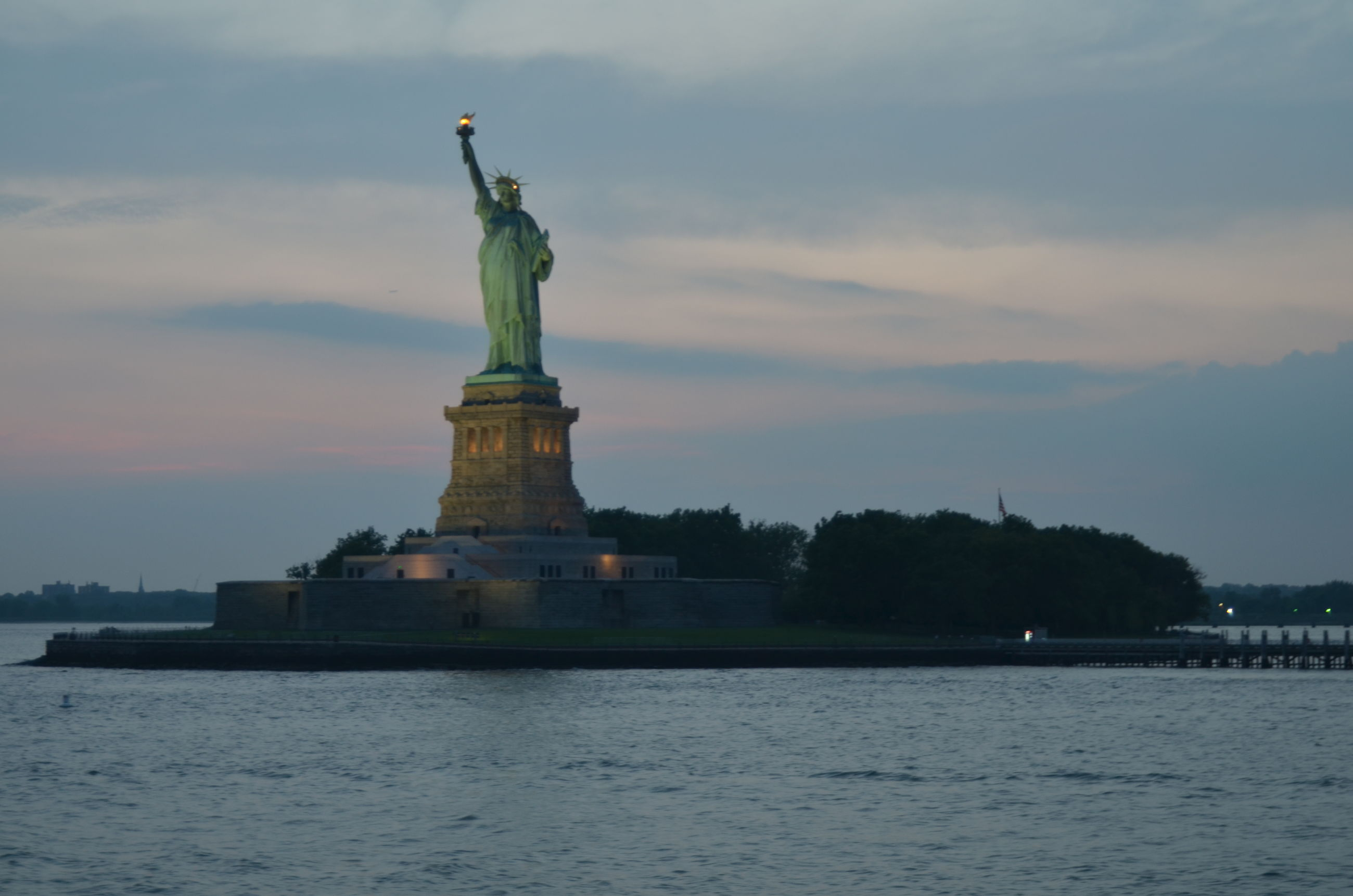 statue, sculpture, human representation, art and craft, art, creativity, sky, water, waterfront, statue of liberty, famous place, animal representation, travel destinations, cloud - sky, built structure, architecture, international landmark, fountain