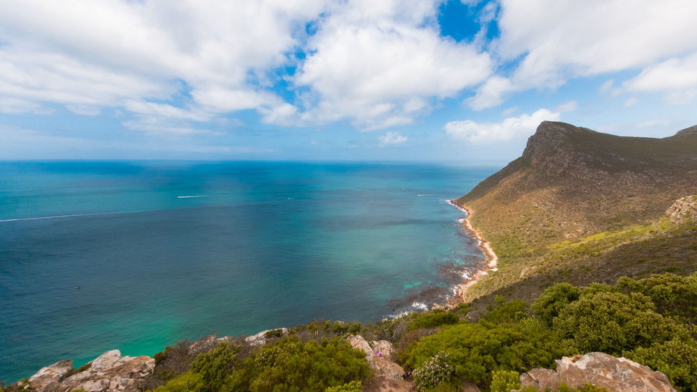 A stunning view over the Cape of Good Hope National Park, South Africa Beauty In Nature Blue Cloud - Sky Horizon Over Water Mountain Nature No People Ocean Outdoors Panoramashot Scenics Sea Sky Tranquil Scene Turquoise Sea Turquoise Water Water