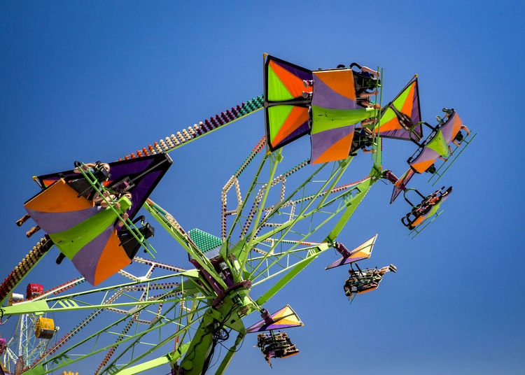 up and around Amusement Park Amusement Park Ride Arts Culture And Entertainment Blue Clear Sky Day Low Angle View Multi Colored Nature Outdoors Real People Sky