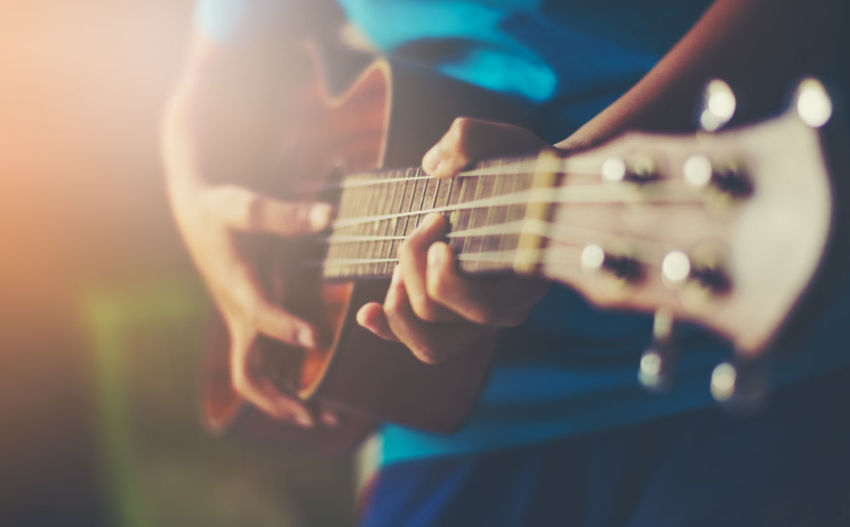boys are practicing guitar. Acoustic Guitar Arts Culture And Entertainment Child Childhood Guitar Hand Holding Music Musical Equipment Musical Instrument Playing Plucking An Instrument Selective Focus String Instrument