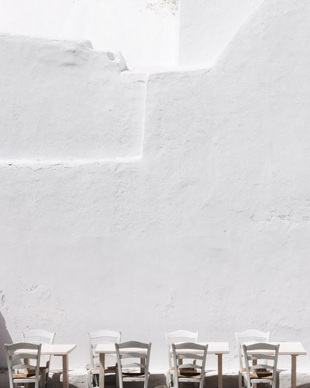 Minimalist Architecture Minimalism Greece Cyclades Travel EyeEmNewHere EyeEm Gallery Travel Photography EyeEm Selects Travel Destinations TheWeekOnEyeEM Vacations EyeEm Best Shots Mykonos Wall - Building Feature Architecture Built Structure Day No People Seat Chair Absence Side By Side