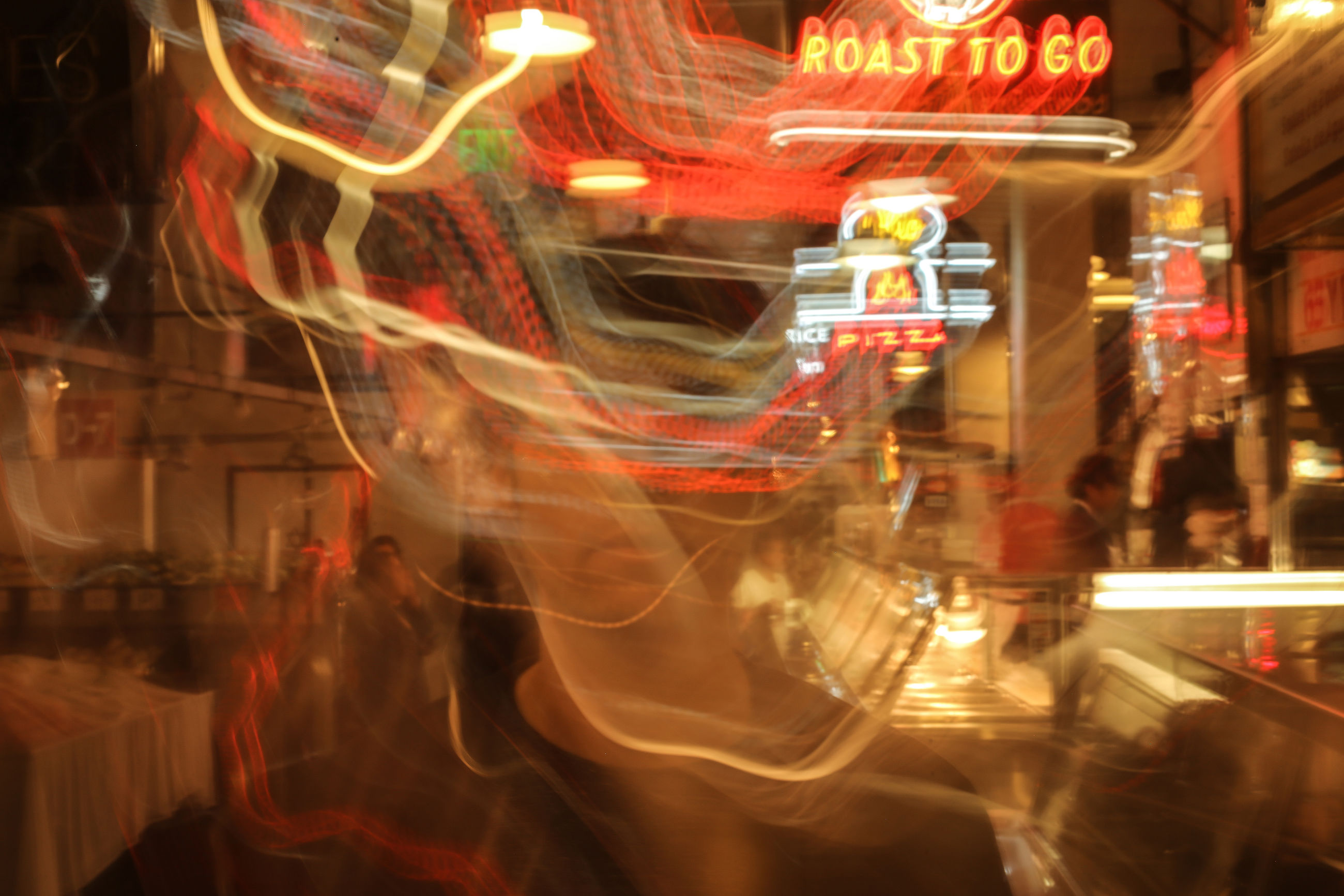night, illuminated, blurred motion, motion, long exposure, arts culture and entertainment, carousel, speed, amusement park ride, nightlife, amusement park, real people, outdoors, neon, close-up