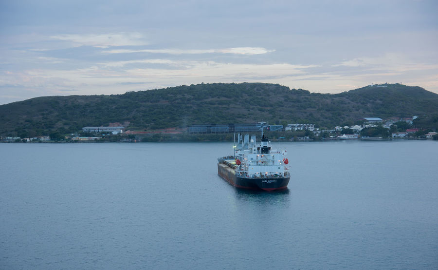 NOUMEA,NEW CALEDONIA-NOVEMBER 25,2016: Jules Garnier II bulk carrier vessel at sunset in the Pacific Ocean harbour in Noumea, New Caledonia. Harbor Noumea Transportation Bulk Carrier Cloud - Sky Freight Transportation Island Landscape Mountain Nature Nautical Vessel New Caledonia Nickel Ore Outdoors Pacific Ocean Scenics Sea Ship Sunset Travel Destinations Vessel Water Waterfront