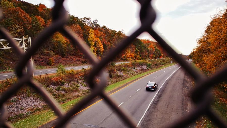 Road seen through chainlink fence