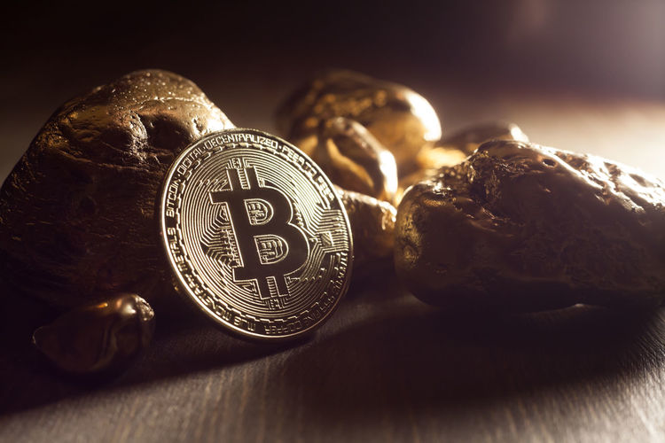 bitcoin and golden nuggets Golden Market Nuggets Treasure Virtual Bitcoin Close-up Coin Compared Cryptocurrency Currency Displayed E-business Exchange Finance Financial Fortune Metal Money Symbol Table Technology Token Trade Wealth