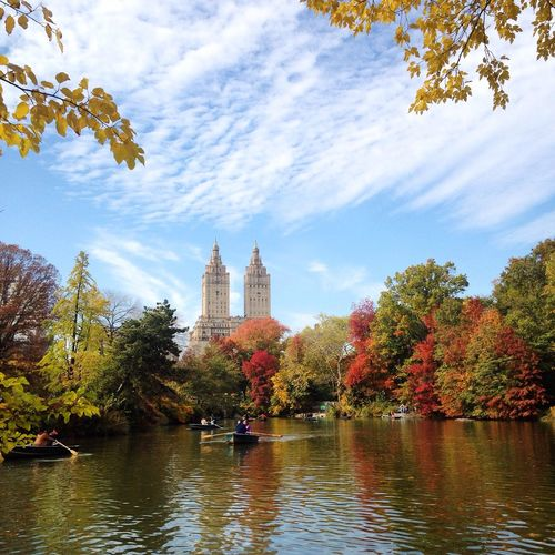 Lake In Central Park By The Eldorado Against Sky During Autumn