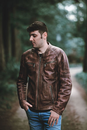 The Portraitist - 2018 EyeEm Awards Nature Casual Clothing Clothing Day Focus On Foreground Forest Front View Fully Unbuttoned Jacket Land Leather Leather Jacket Leisure Activity Lifestyles Looking One Person Outdoors Real People Standing Three Quarter Length Tree Young Adult Young Men
