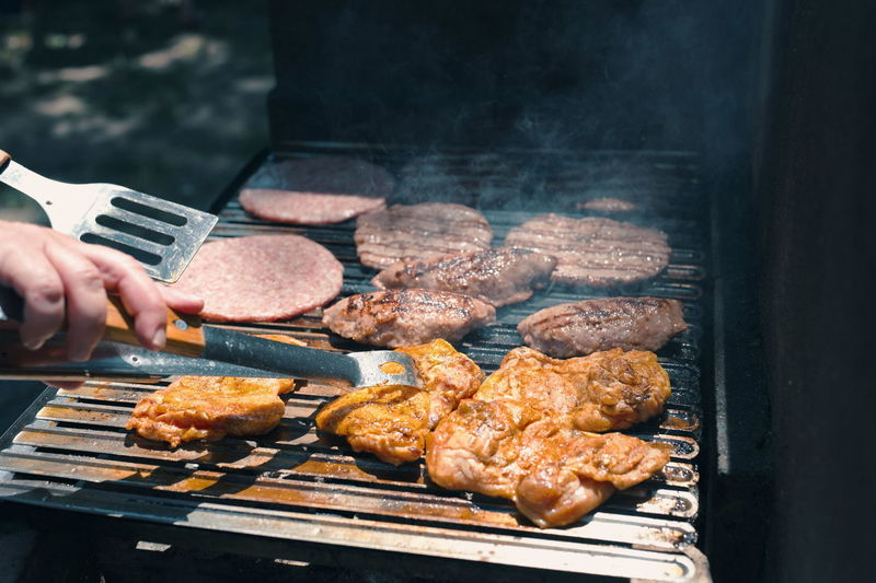 Assorted delicious grilled meat on barbecue