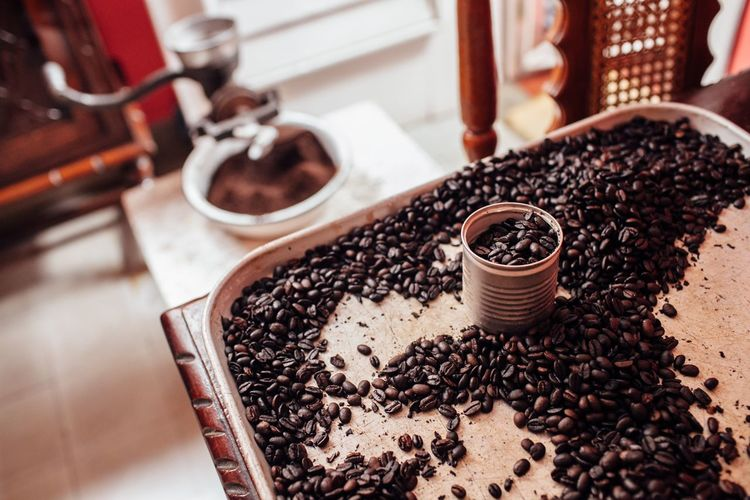 High angle view of coffee beans in tray on table