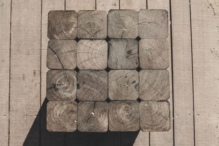 Directly above shot of stack on hardwood floor