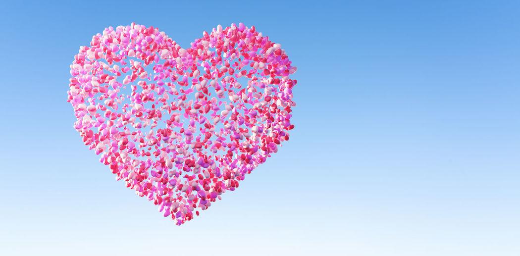 Close-up of heart shape against blue sky