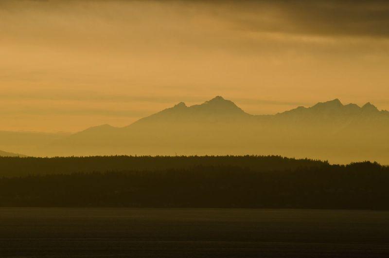 Scenic View Of Mount Ellinor Against Orange Sky