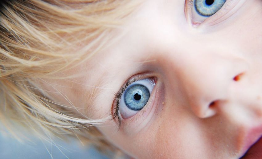 Close-up portrait of boy with blue eyes