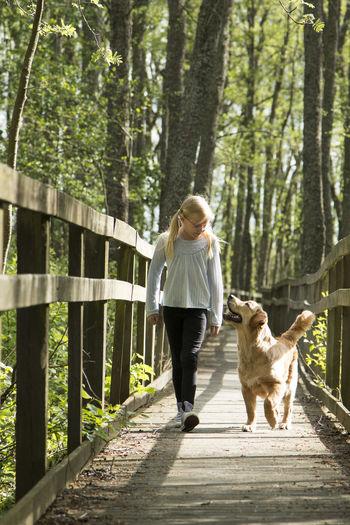 Girl walking on footbridge