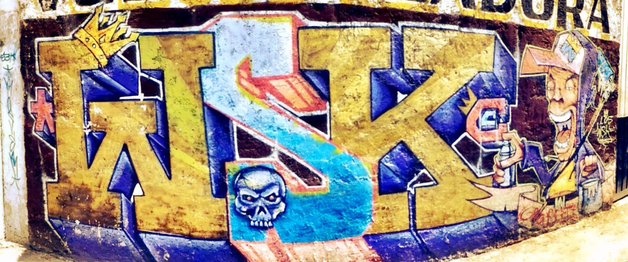 art, creativity, art and craft, graffiti, text, multi colored, wall - building feature, western script, communication, built structure, architecture, blue, wall, human representation, street art, close-up, mural, painting, building exterior, no people
