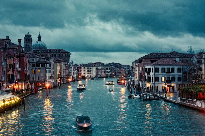 Venice, 2010. EyeEm Best Shots Venice Architecture Building Exterior Built Structure Water Transportation Mode Of Transportation City Nautical Vessel Illuminated Cloud - Sky Travel Destinations Canal Travel Night Sky Residential District Building Incidental People