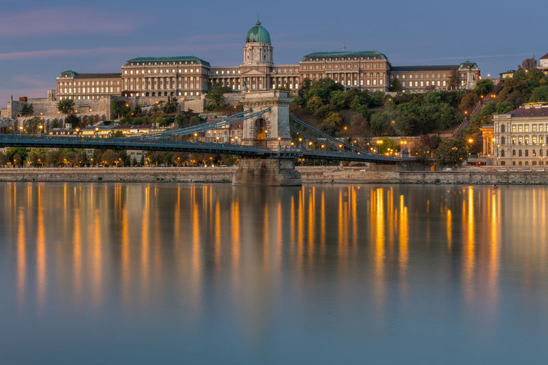Sunrise in budapest, chain bridge with the palace palace in the background.
