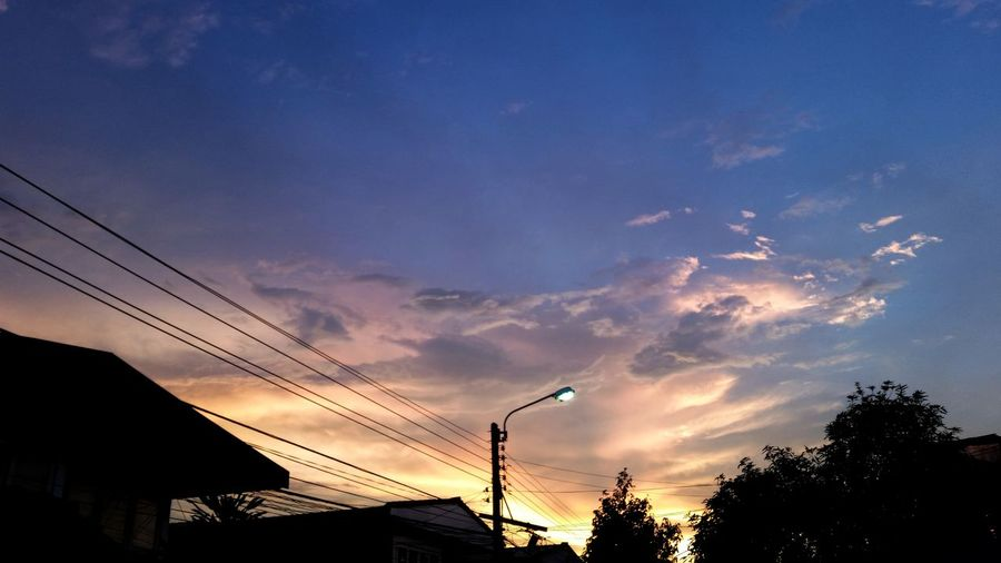 Low angle view of dramatic sky at sunset