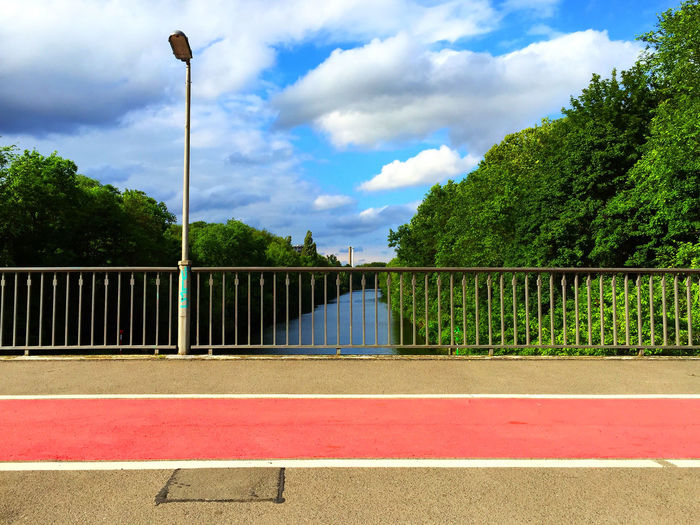 cycle track on bridge Balustrade Bicycle Path Bicycle Track Bridge Bridge View Canal Canal Walks Canals And Waterways Cloud - Sky Cycle Path Cycle Track Day Green Color Handrail  Lamp Nature No People Outdoors Sky Street Lamp Teltow Teltow Kanal Teltowkanal Trees Trees And Sky