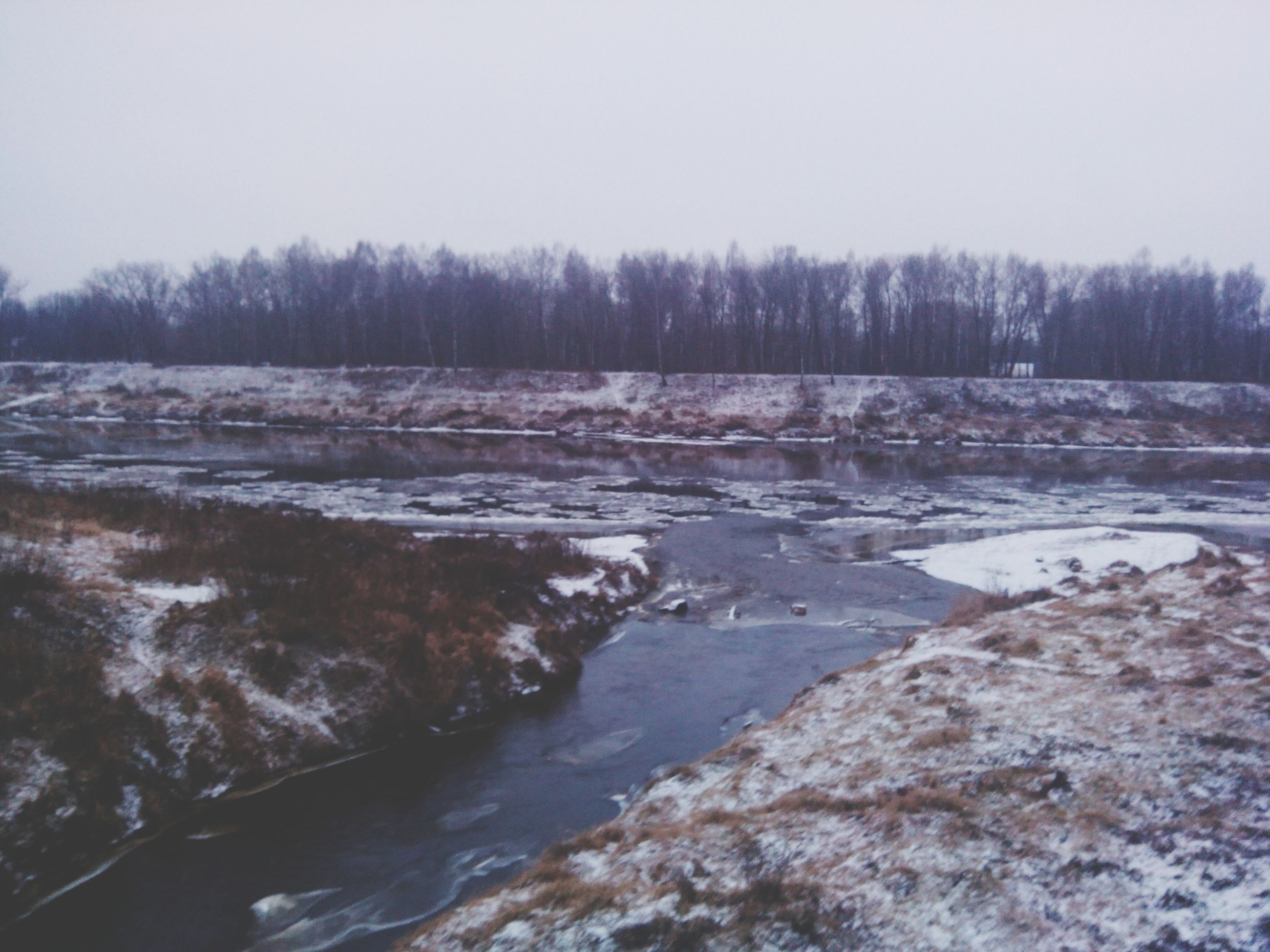 clear sky, tranquility, water, tranquil scene, winter, nature, tree, cold temperature, scenics, snow, beauty in nature, copy space, weather, river, frozen, season, day, non-urban scene, outdoors, no people