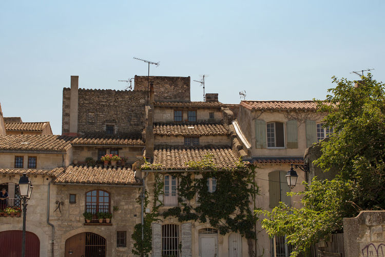 Building exterior at the old town, Arles Architecture Building Exterior Built Structure City City Life Clear Sky Day Historic Ivy No People Old Town Outdoors Residential Building Residential District Residential Structure Roof Sky Tourism Town Travel Destinations Tree Window