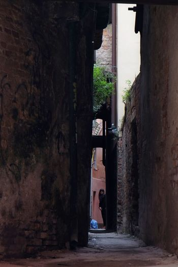 Narrow way to home. Venice angle of view. Built Structure History Cultures Outdoors One Woman Venetian Labyrinth