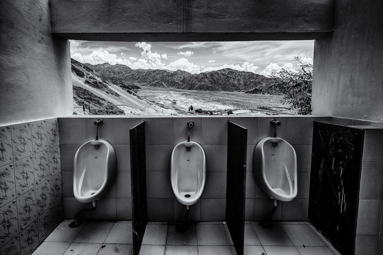 Empty Toilet Against Landscape